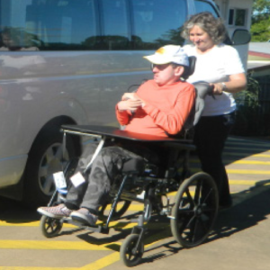 Spiral helping a client in a wheelchair